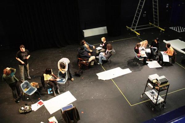Looking down from the drama studio gallery on drama degree students preparing.