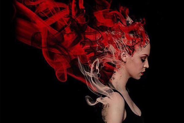 Graphic design degree course student artwork - woman with red hair dissolving into flames