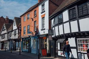 A shot of the outside of independent shops in Tudor buildings in the Shambles road.