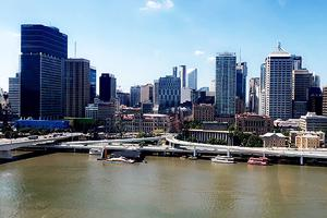 view of a river in the foreground and high rise buildings in the distance
