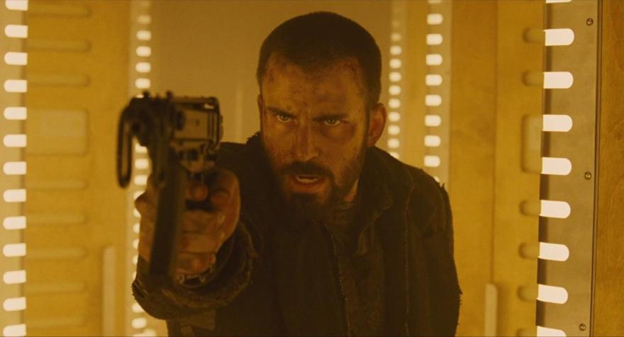 A still from the film Snowpiercer of a man aiming a gun at the camera