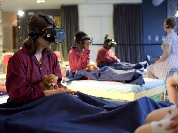 Several people are sitting up in beds wearing virtual reality helemts