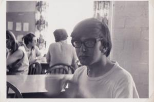 man with large glasses in the 1960s