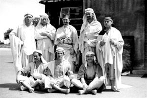 eight sheikh men standing in a group