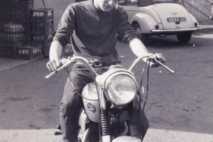 Man on a motor bike in the 1960s