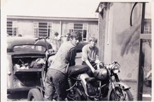 Two men on a motorbike in the 1960s