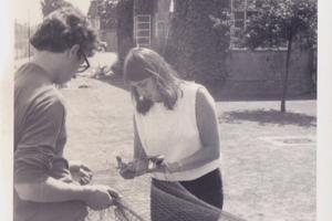 Two people holding a net in the 1960s