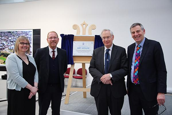 Sarah Greer, David Broster, The Duke of Gloucester and Professor David Green stand in a line in front of a stand