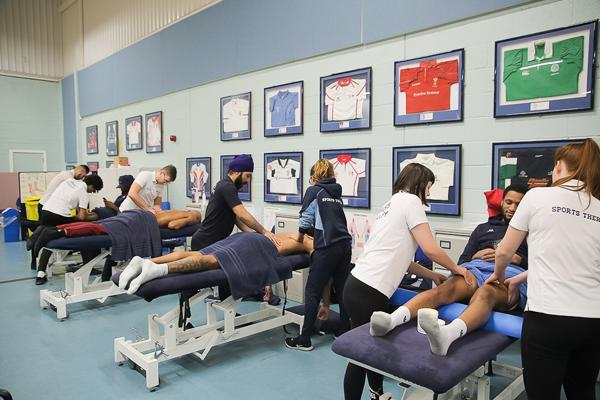 Sports Therapy degree students working at a clinic