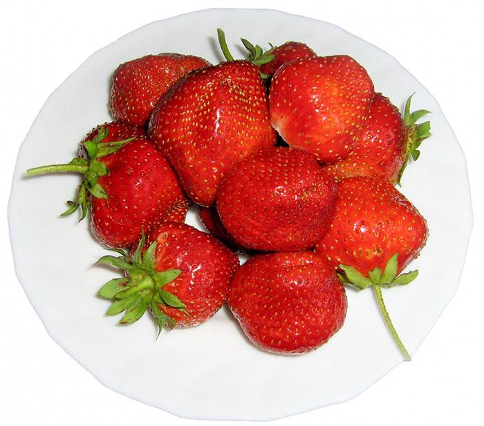 A close up picture of a bowl of strawberries