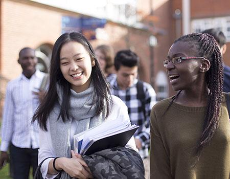 Two female students arrive on campus after receiving their place through university clearing.