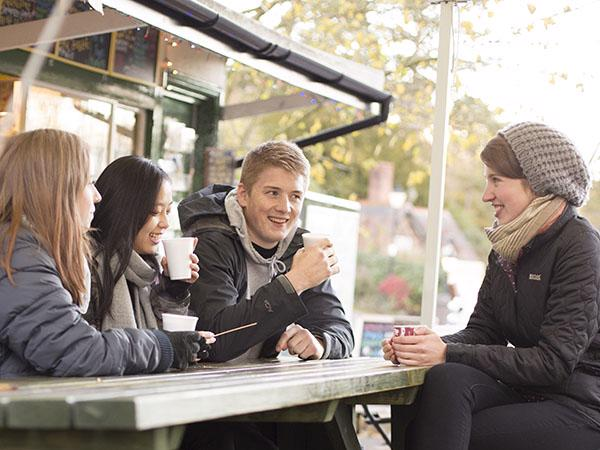 Students drink coffee outdoors