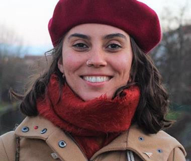 Portrait photo of Erica in a red hat and scarf
