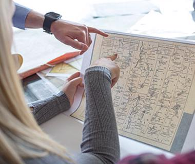 students pointing at a map