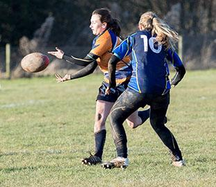 women's rugby players during a game