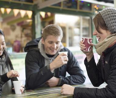 Students drinking coffee on campus